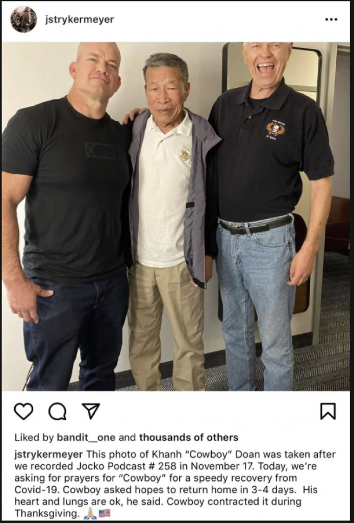 Jocko Willink standing beside 70 year old veteran without any mask or social distancing